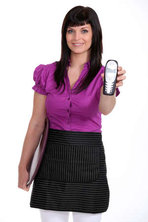 Waitress holding a cordless phone Stock Photo - 12217993