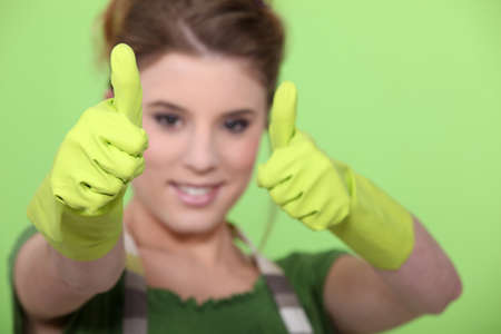 housewife making a thumbs up sign photo