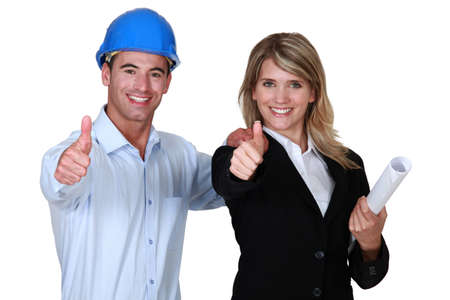 protection plan: Male and female architect thumbs