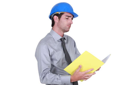 businessman wearing helmet taking notes Stock Photo - 12217843