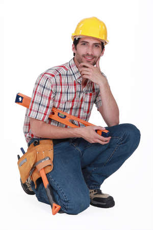 commercial construction: Kneeled handyman.