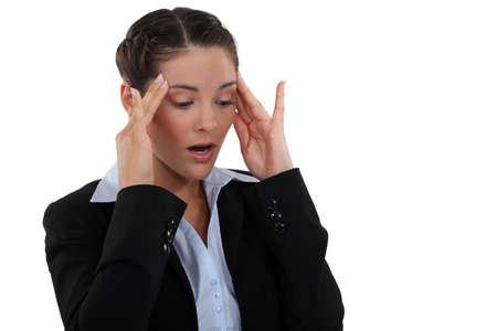 cephalgia: Woman massaging her head