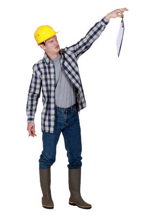 safety boots: A repulsed tradesman dangling a clipboard