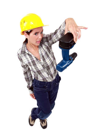 confound: Confused woman holding drill
