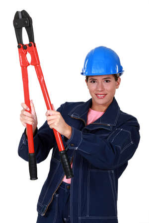 Woman builder holding nippers photo