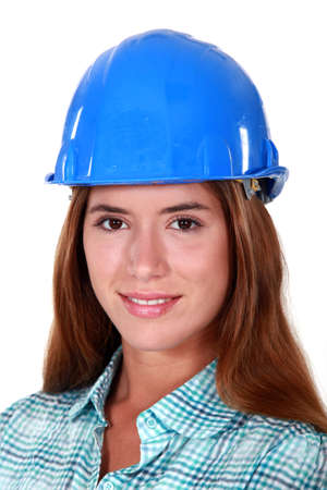 assertion: Closeup of a woman in a hardhat Stock Photo
