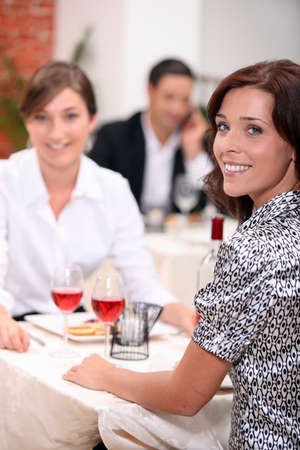 sociable: Women eating out in a restaurant together Stock Photo