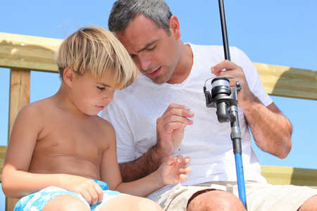 father and son fishing Stock Photo - 12218380