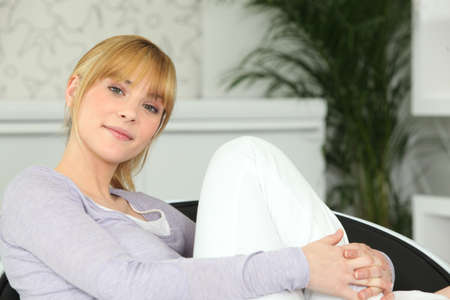 Teenage girl relaxing at home photo
