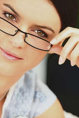 Elegant woman wearing eyeglasses photo