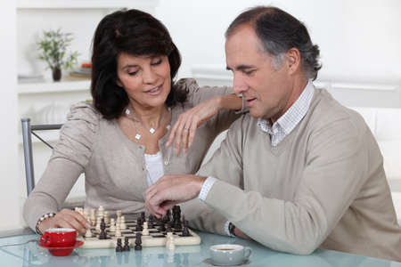 pawn adult: Middle-aged couple playing chess