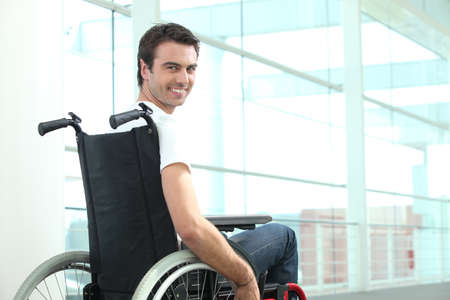handicapped accessible: Happy man in wheelchair