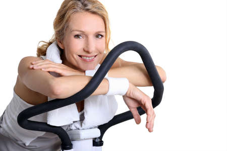 home gym: portrait of a woman on exercise bike Stock Photo