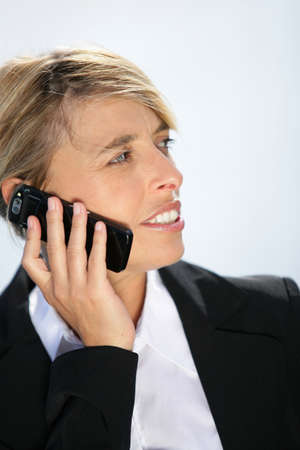 Businesswoman talking on her mobile phone Stock Photo - 12218101