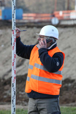 surveyor taking measurements Stock Photo - 12218554