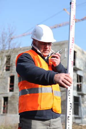 55 60 years: Surveyor on construction site