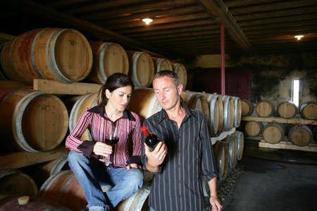 oenology: Winemakers drinking wine in a winery