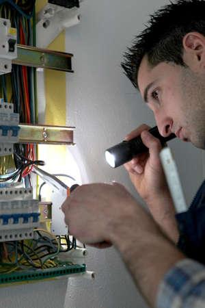 Man repairing electrical panel photo