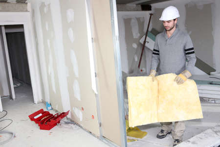 foam safe: Builder carrying wall insulation