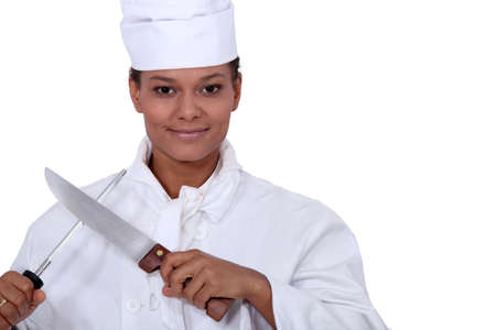 pointed arm: Cook sharpening knife