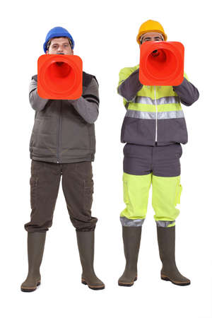 the unskilled worker: Tradesmen using pylons as megaphones