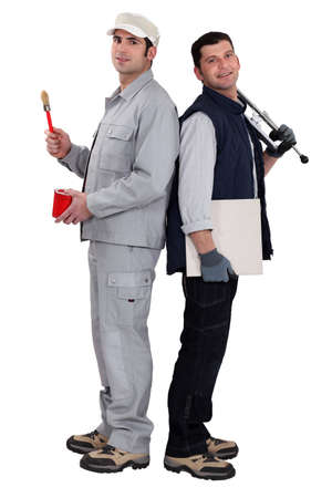 Tradesmen standing back to back Stock Photo - 12219064