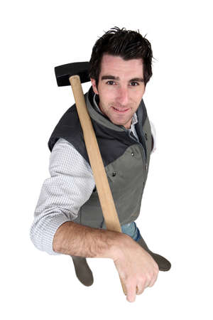 sledgehammer: Man carrying sledge-hammer