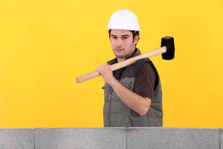 stonemasonry: Construction worker holding a mallet Stock Photo