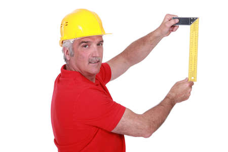 portrait of mature carpenter with meter isolated on white Stock Photo - 12218900