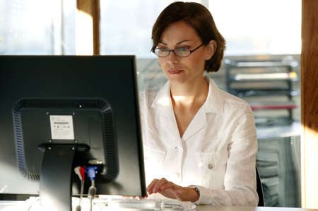 executive job search: Busy female office worker