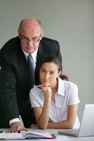 Senior businessman with a young colleague photo