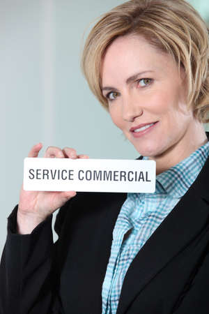 Woman holding Service Commercial sign Stock Photo - 12219756