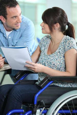 wheelchair woman: Woman in a wheelchair
