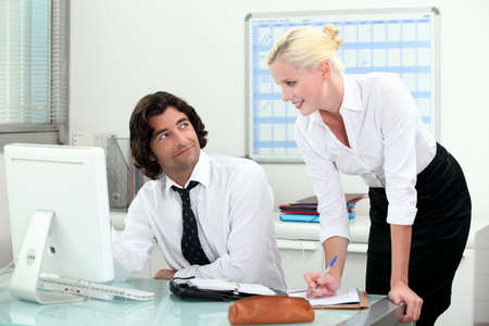 Attractive couple working in an office photo