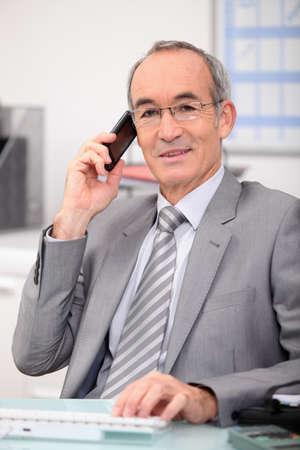 chairman: senior businessman on the phone Stock Photo