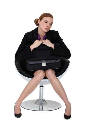Shy applicant waiting on an armchair photo