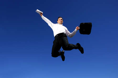 Successful businessman jumping in the air photo