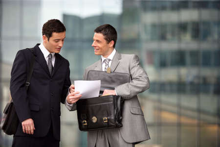 collaborators: Two lawyers discussing outdoors