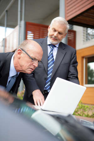 car sales: Two senior businessmen on a sales call