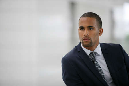 hazel eyes: Portrait of a young Afro businessman