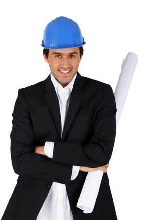 Businessman with architect plan photo