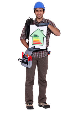 and heating: Tradesman holding an energy efficiency rating chart