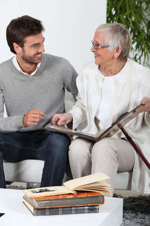 Elderly person looking at photos with son Stock Photo - 12219868