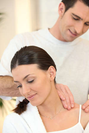 30 35: Man giving his wife a massage Stock Photo