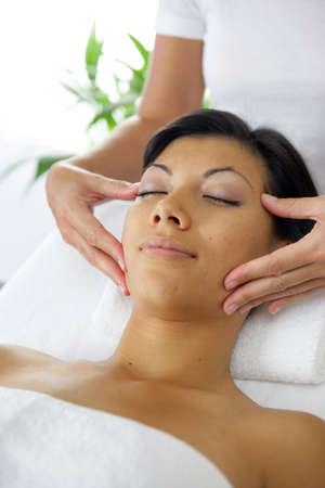 Woman getting a face massage Stock Photo - 12219021