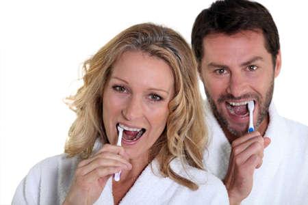 woman and man brushing teeth Stock Photo - 12219382