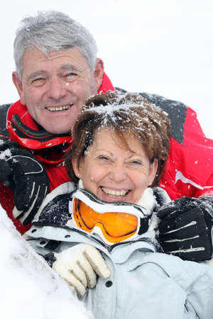 Portrait of a mature couple covered with snowflakes photo