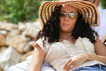 Young woman having a sunbath photo