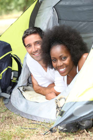 Couple camping in tent