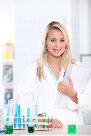 Young student with test tube rack and notes Stock Photo - 12219268